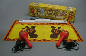 The Wii version doesn't have the mat and the Wiimotes click into the inside of the maracas.